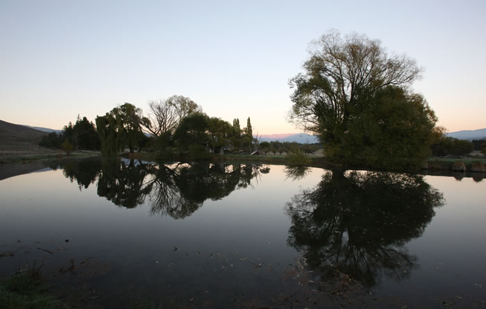 Reflections on the Omarama Station farm dam